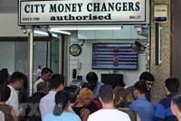 Singapore siết chặt chính sách tiền tệ
