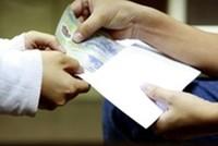Cán bộ thuế nhận lót tay 50 triệu đồng của doanh nghiệp