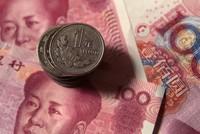 Sự thật đằng sau việc hạ giá NDT của Trung Quốc