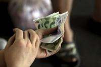 PBOC: Không cần thiết hạ giá thêm đồng nhân dân tệ