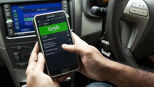 Xe Grab có thể phải gắn mào 'taxi điện tử' trên nóc