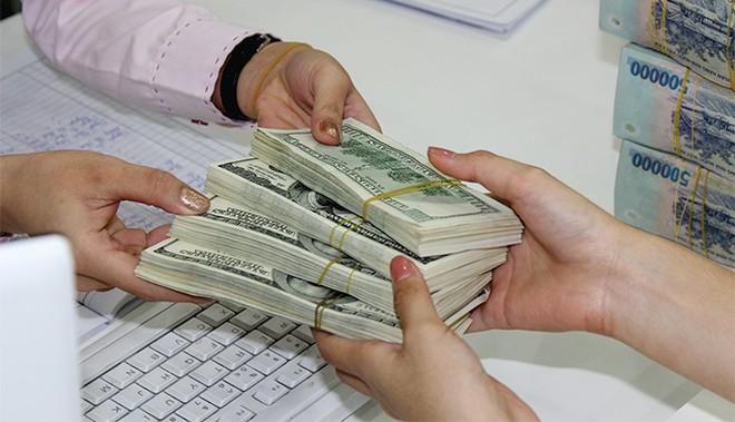 Phá giá đồng Việt Nam, bao nhiêu là đủ?