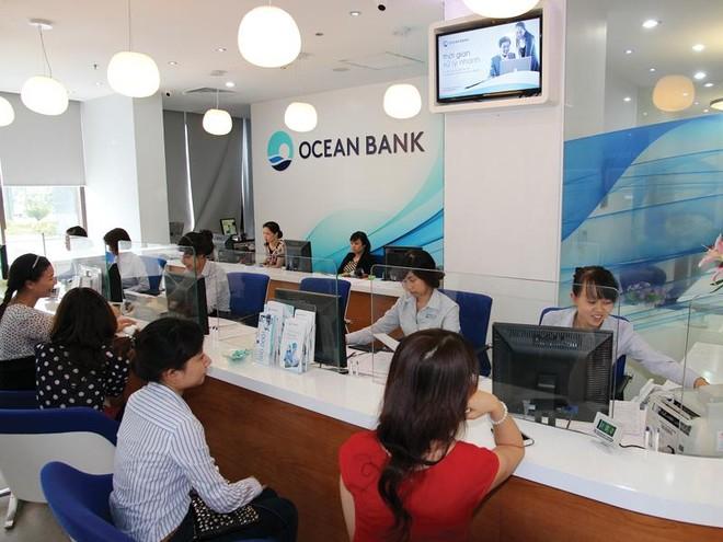 Gỡ nợ xấu, M&A ngân hàng bùng nổ